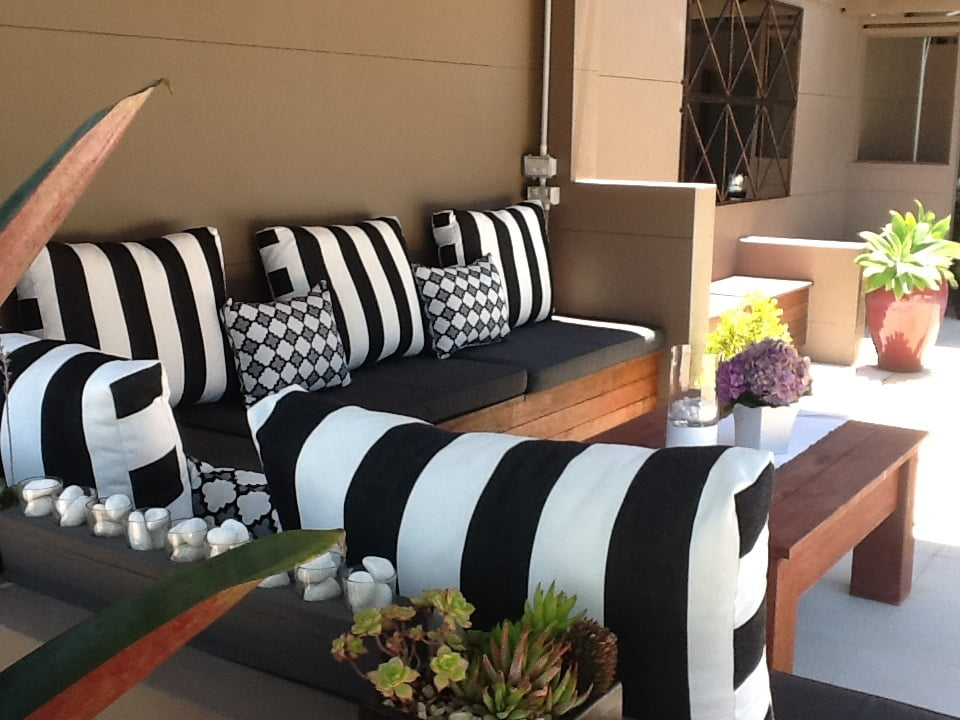 Four Reasons Why Black And White Outdoor Cushions Suit Your Outdoors